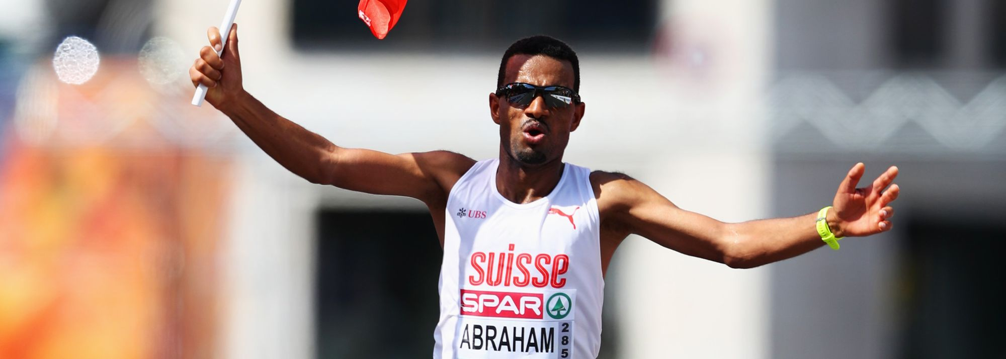 It would be understandable for anyone to be fazed by the presence of an athlete like Eliud Kipchoge in their event. But for Tadesse Abraham, competing against the Kenyan icon is a modest challenge compared to what he faced as a young refugee.