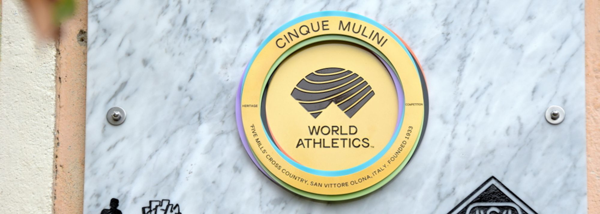 Cinque Mulini's World Athletics Heritage Plaque is unveiled on the side of the Meraviglia Mill