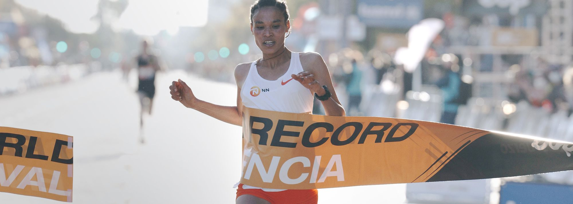 World and Olympic medallist adds half marathon mark to her world records for 5000m and 10,000m