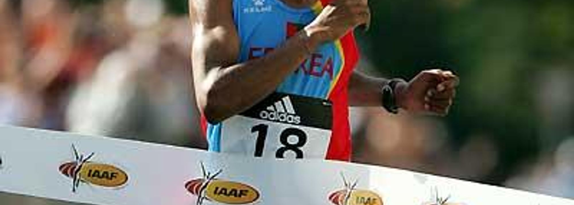 Zersenay Tadesse, 2004 Olympic 10,000m bronze medallist, secured his and Eritrea's first global title, just 13 seconds adrift of the World record for 20km. In doing so he convincingly won the inaugural men's title at the IAAF World Road Running Championships this afternoon, on a 5km loop course whose start and finish was in front of the imposing edifice of the neo-classical main building of Debrecen University.