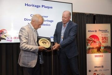 Long-time MVD meeting director Wilfried Meert receives the World Athletics Heritage Plaque from Chris Turner