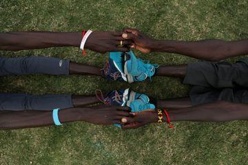 Gai Nyang Tap and Wiyual Puok Deng of the Athlete Refugee Team in Nassau