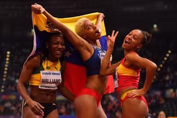 Kimberly Williams, Yulimar Rojas and Ana Peleteiro celebrate their top-three finish at the IAAF World Indoor Championships Birmingham 2018